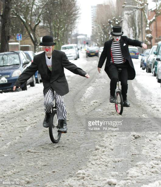 Clowns wearing full costume arrive at a service in memory of celebrated clown Joseph Grimaldi at the Holy Trinity Church in Dalston east London