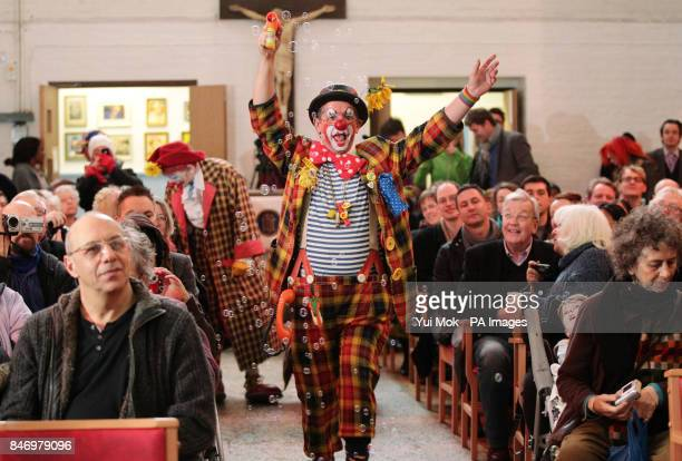 Clowns wearing full costume attend a service in memory of celebrated clown Joseph Grimaldi at the Holy Trinity Church in Dalston east London