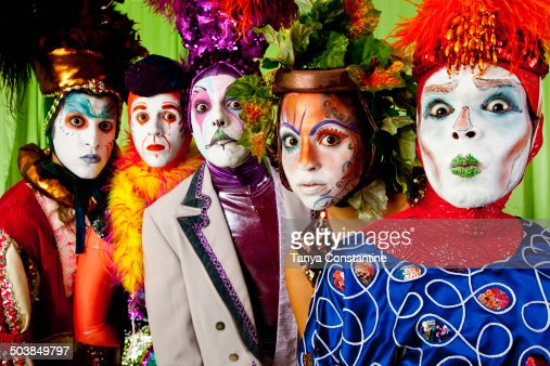 Clowns wearing theatrical makeup