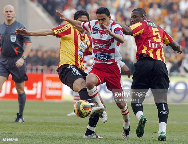 Club Africain player midfielder Wissam vies with Esperance de Tunis players Idgar Louee and Wissem Abdi during the Tunisia capital derby Premiership...