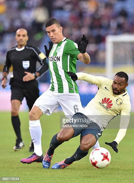 Club America midfielder William Da Silva and Atletico Nacional midfielder Mateus Uribe tussle for the ball during the Club World Cup thirdplace...