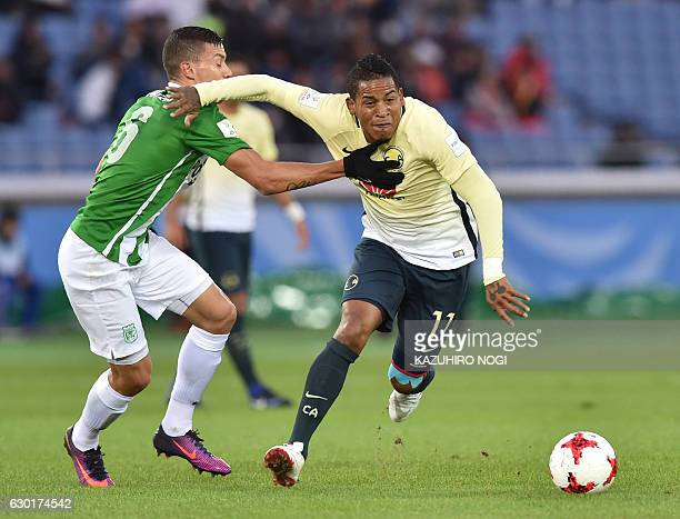 Club America's forward Michael Arroyo and Atletico Nacional midfielder Mateus Uribe fight for the ball during the Club World Cup thirdplace playoff...