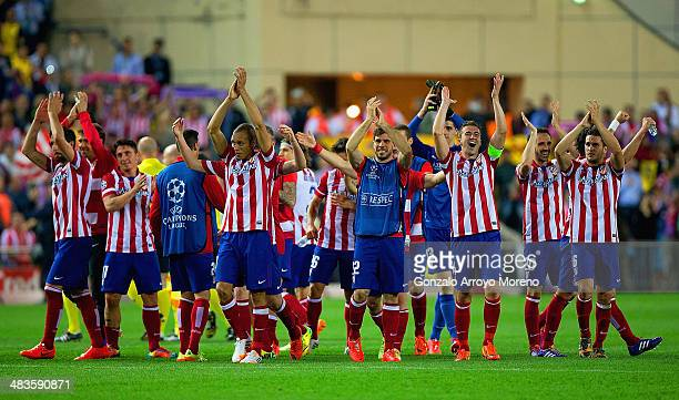 Club Atletico de Madrid applaud their fans as they celebrate victory during the UEFA Champions League Quarter Final second leg match between Club...