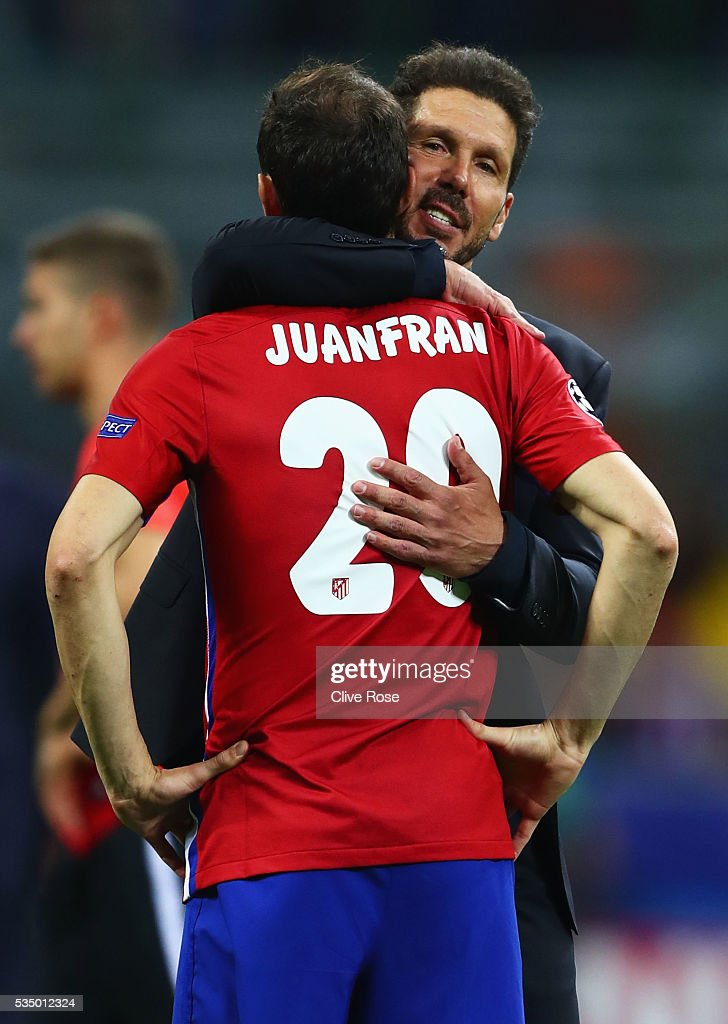 Club Atletico de Madrid head coach <a gi-track='captionPersonalityLinkClicked' href=/galleries/search?phrase=Diego+Simeone&family=editorial&specificpeople=226872 ng-click='$event.stopPropagation()'>Diego Simeone</a> hugs a desperate <a gi-track='captionPersonalityLinkClicked' href=/galleries/search?phrase=Juanfran+-+Voetballer+rechtsachter+geboren+1985&family=editorial&specificpeople=2634439 ng-click='$event.stopPropagation()'>Juanfran</a> after the UEFA Champions League Final match between Real Madrid and Club Atletico de Madrid at Stadio Giuseppe Meazza on May 28, 2016 in Milan, Italy.