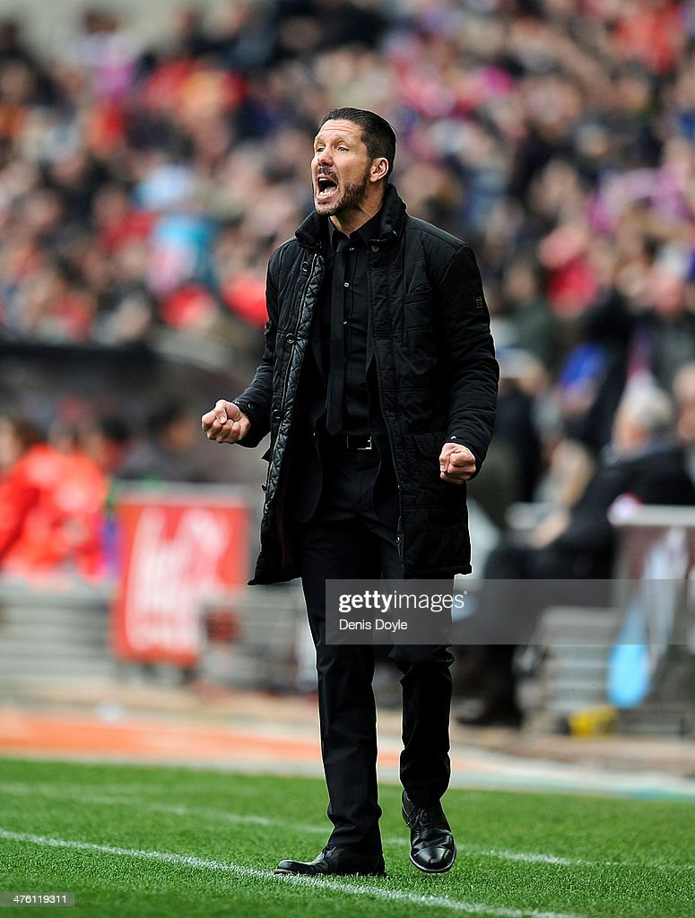 Club Atletico De Madrid head coach <a gi-track='captionPersonalityLinkClicked' href=/galleries/search?phrase=Diego+Simeone&family=editorial&specificpeople=226872 ng-click='$event.stopPropagation()'>Diego Simeone</a> reacts after his team scored their opening goal during the La Liga match between Club Atletico de Madrid and Real Madrid CF at Vicente Calderon Stadium on March 2, 2014 in Madrid, Spain.