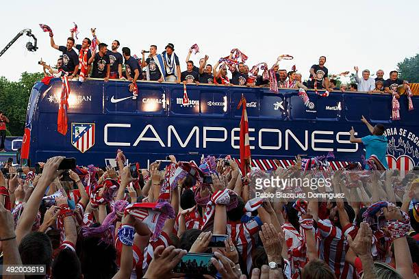 Club Atletico de Madrid players arrive on bus celebrating with the fans after their tenth La Liga title at Neptuno Square on May 18 2014 in Madrid...