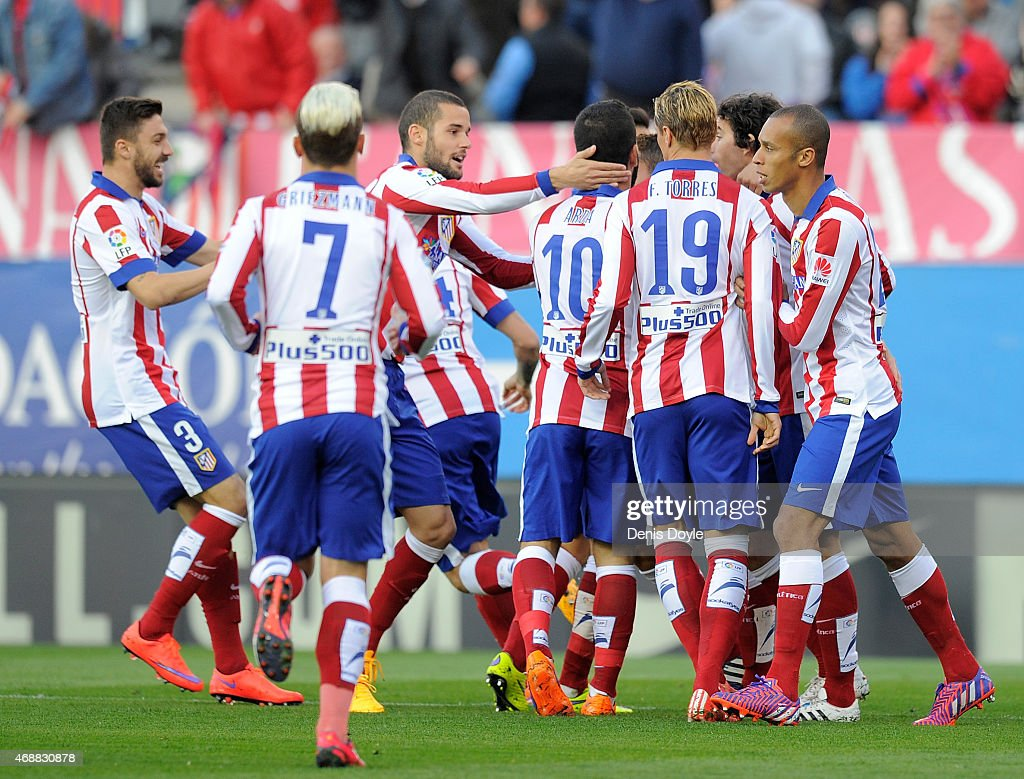 Club Atletico de Madrid players celebrate after Mikel Gonzalez of Real Sociedad scored an own goal during the La Liga match between Club Atletico de...