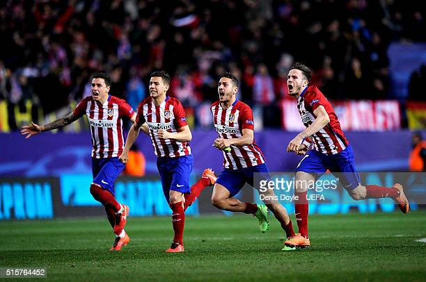Club Atletico de Madrid players celebrate after they won an extra time penalty shootout during the UEFA Champions League round of 16 second leg match...