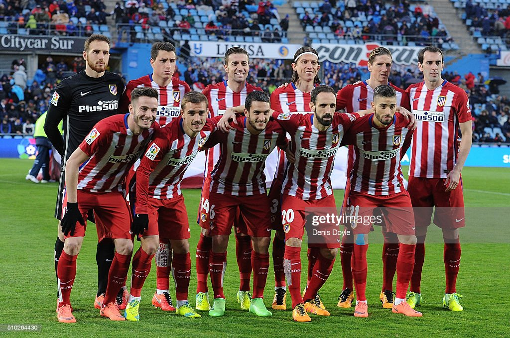 Club Atletico de Madrid players line-up for a group photograph before ...