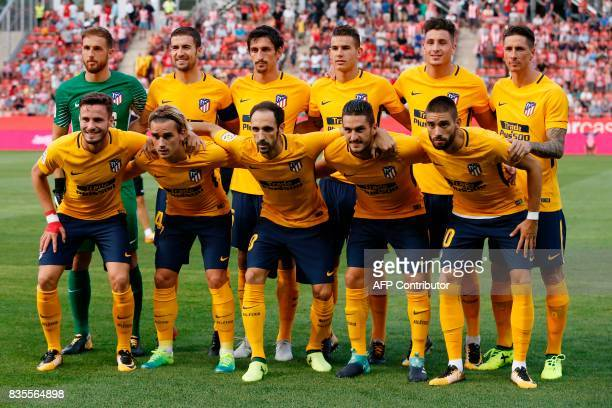 Club Atletico de Madrid's players pose during a line up before the Spanish league football match vs Girona FC at the Municipal de Montilivi stadium...