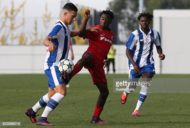 Club Brugge KV's midfielder Singa Joel Ito with FC Porto's defender Diogo Dalot in action during the UEFA Youth Champions League match between FC...