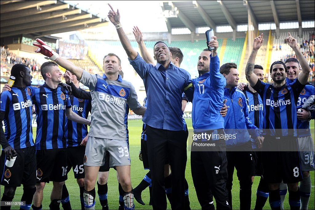 Club Brugge players celebrate during the Jupiler Pro League play-off 1 match between Club Brugge and Sporting Lokeren on May 5, 2013 in Brugge, Belgium.