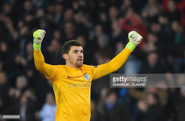 Club Brugge's Australian goalkeeper Mathew Ryan celebrates after his team's victory in the UEFA Europa League Round of 16 match between Club Brugge...