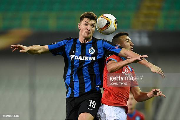 Club Brugges Belgian defender Thomas Meunier vies for the ball with Napoli's Moroccan midfielder Omar El Kaddouri during a UEFA Europa League Group D...