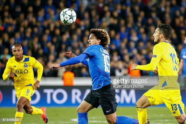 Club Brugge's brazilian forward Felipe Gedoz makes his way through Porto's algerian forward Yacine Brahimi and Porto's brazilian defender Alex Telles...
