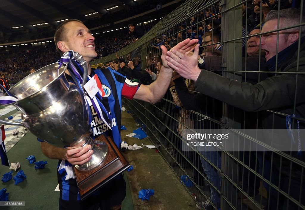 Club Brugge's captain <a gi-track='captionPersonalityLinkClicked' href=/galleries/search?phrase=Timmy+Simons&family=editorial&specificpeople=794114 ng-click='$event.stopPropagation()'>Timmy Simons</a> celebrates with supporters after winning the Belgian Cofidis cup final football game between Club Brugge KV and RSC Anderlecht on March 22, 2015 at the Roi Baudouin stadium in Brussels.