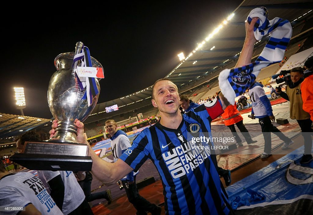 Club Brugge's captain <a gi-track='captionPersonalityLinkClicked' href=/galleries/search?phrase=Timmy+Simons&family=editorial&specificpeople=794114 ng-click='$event.stopPropagation()'>Timmy Simons</a> jubilates after winning the Belgian Cofidis cup final football game between Club Brugge KV and RSC Anderlecht on March 22, 2015 at the Roi Baudouin stadium in Brussels.