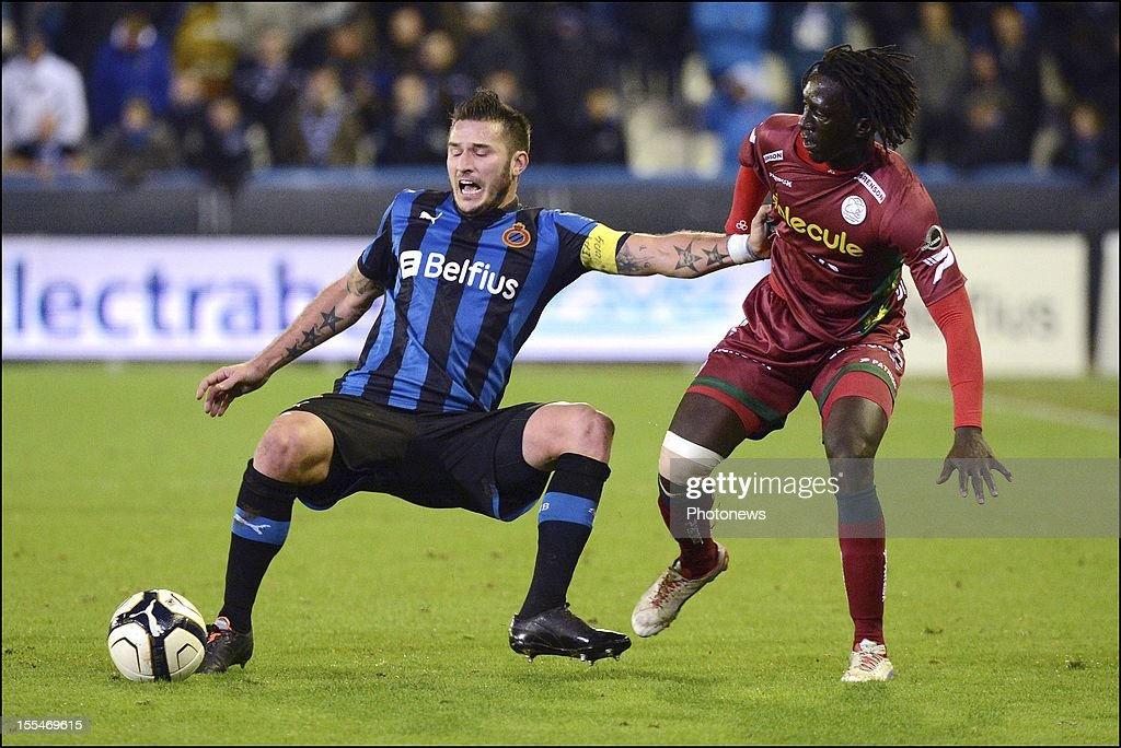 Club Brugge's Carl Hoefkens challenges Zulte Waregem's Mbaye Leye during the Jupiler Pro League match between Club Brugge and Zulte Waregem on November 4, in Brugge, Belgium.