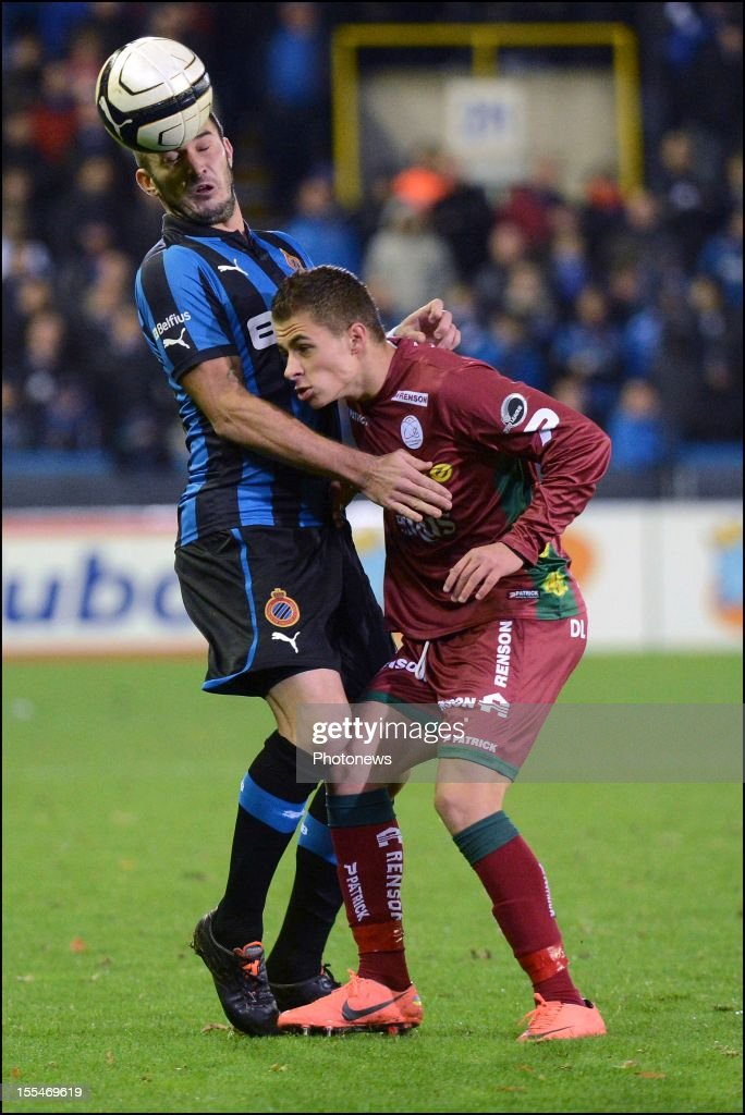 Club Brugge's Carl Hoefkens challenges Zulte Waregem's Thorgan Hazard during the Jupiler Pro League match between Club Brugge and Zulte Waregem on November 04 in Brugge, Belgium.