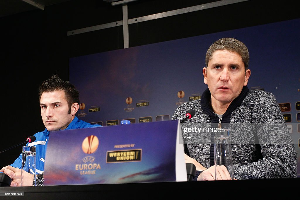 Club Brugge's player Carl Hoefkens and Club's head coach Juan Carlos Garrido give a press conference on November 21, 2012 in Bruges on the eve of their Europa League match against Bordeaux.
