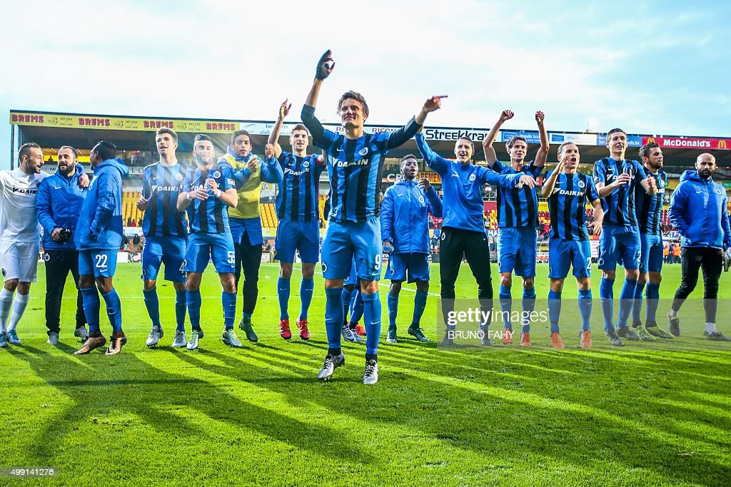 Club Brugge's players celebrate after winning the Jupiler Pro League match between KV Mechelen and Club Brugge on November 29 2015 in Mechelen on day...