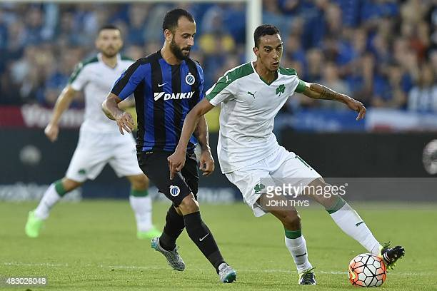 Club Brugge's Spanish midfielder Victor Vazquez challenges Panathinaikos' Portuguese midfielder Zeca during the UEFA Champions League third round...