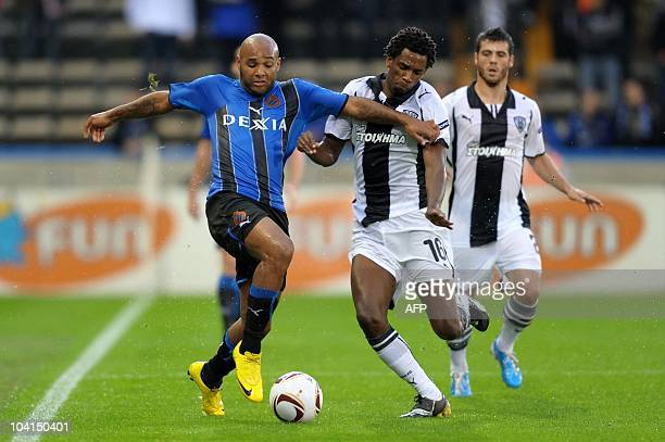 Club Brugges' Wilfried Dalmat fights for the ball with PAOK Salonika's Lino during the Europa League football match between Club Brugges and Greek...