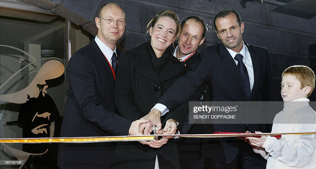 Club director William Froidville Justine Henin school director Olivier Jeunehomme and coach Carlos Rodriguez cut the ribbon during the inauguration...