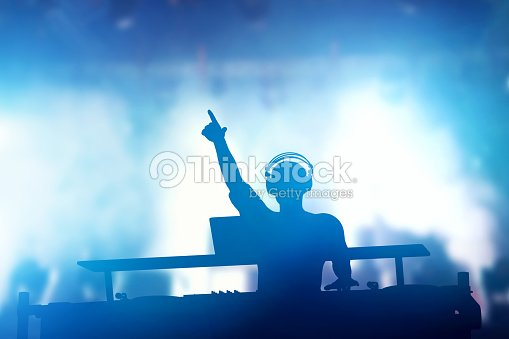 Club, disco DJ playing and mixing music for people. Nightlife : Stock Photo