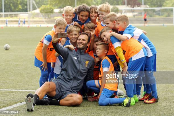 Club legend Patrik Berger of Liverpool FC pose with youngsters during the Hertha BSC soccer camp at Olympiastadion on July 28 2017 in Berlin Germany