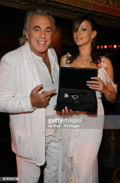 Club owner Peter Stringfellow and dancer Bella pose with 'The Jewel' the world's most expensive vibrator valued at 1million and made from solid...