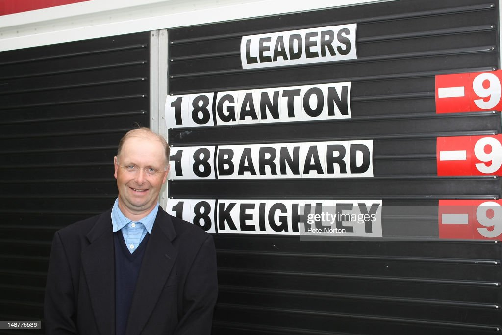 Club Professional <a gi-track='captionPersonalityLinkClicked' href=/galleries/search?phrase=Gary+Brown&family=editorial&specificpeople=196518 ng-click='$event.stopPropagation()'>Gary Brown</a> of Ganton Golf Club poses with the scoreboard after winning the Virgin Atlantic PGA National Pro-Am Championship - Regional Final at Fulford Golf Club on July 19, 2012 in Fulford, England.