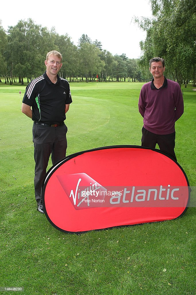 Club professional Tony Varney (l) of Bawburgh Golf Club and amateur Phil Longhurst pose after victory in the Virgin Atlantic PGA National Pro-Am Championship - Regional Final at Kings Lynn Golf Club on July 16, 2012 in King's Lynn, England.