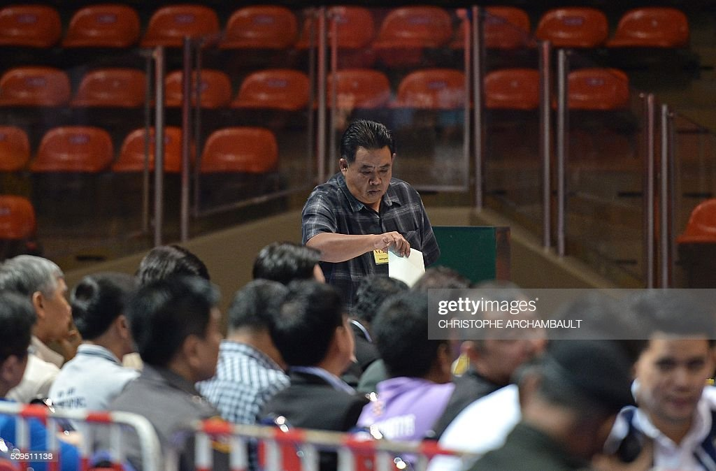 A club representative casts his ballot during the election of the president of the Football Association of Thailand at a stadium in Bangkok on February 11, 2016. Former Thai national police chief Somyot Poompanmoung, who was backed by Leicester City's billionaire owners, was elected as president of the embattled Football Association of Thailand, in a vote prompted by the suspension of the scandal-mired former boss. AFP PHOTO / Christophe ARCHAMBAULT / AFP / CHRISTOPHE ARCHAMBAULT