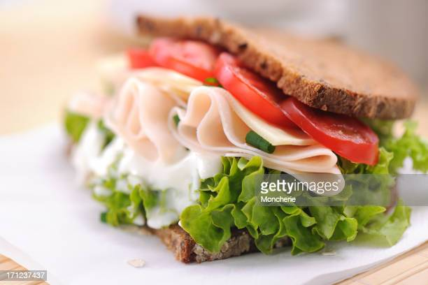 Club sandwich with chicken ham and whole wheat bread