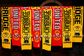Club scarves are displayed for sale outside the stadium before the FA Cup Fourth Round match between Cambridge United and Manchester United at The R...