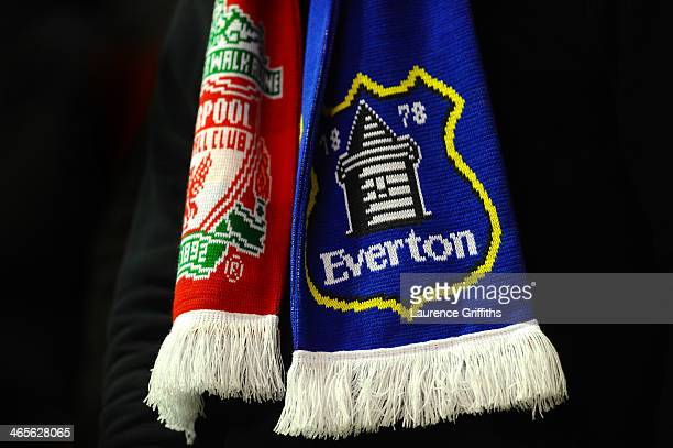 Club scarves are seen prior to kickoff during the Barclays Premier League match between Liverpool and Everton at Anfield on January 28 2014 in...