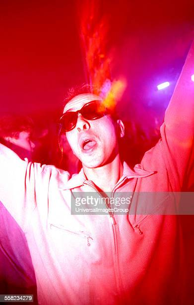 A clubber on the main dancefloor of the Hacienda Manchester 1988