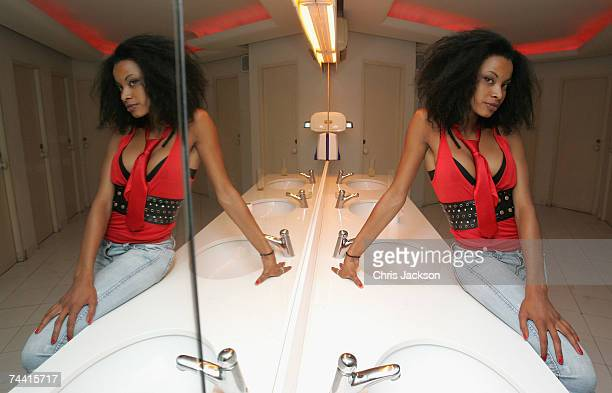 A clubber poses for a photograph in the restrooms of Pasha nightclub in Eivissa town on June 5 2007 in Ibiza Spain Pacha will celebrate its 34th...