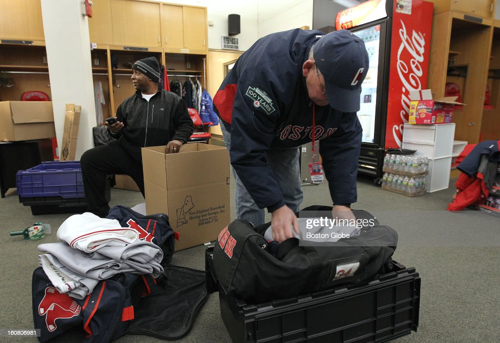 Clubhouse worker Martin Nicholson, front, and equipment manager Edward Jackson continue packing. The Red Sox equipment truck gets packed and leaves Boston for Florida, on Tuesday, Feb. 5, 2013.