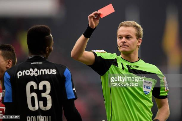 Club's Boli Bolingoli Mbombo receives a red card from referee Bart Vertenten during the Jupiler Pro League match between Standard de Liege and Club...