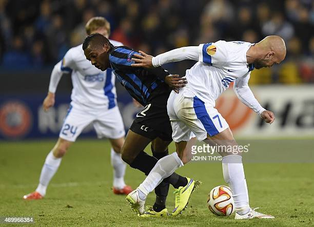 Club's Jose Izquierdo vies with Dnipro's Jaba Kankava during the UEFA Europa League quarterfinal football match between Club Brugge and...