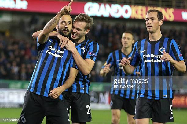 Club's Victor Vazquez Solsona celebrates with his teammates after scoring during their match Belgium's Brugge and Danish team FC Kobenhavn on October...