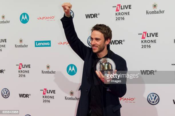 Clueso celebrate his award during the 1Live Krone at Jahrhunderthalle on December 1 2016 in Bochum Germany