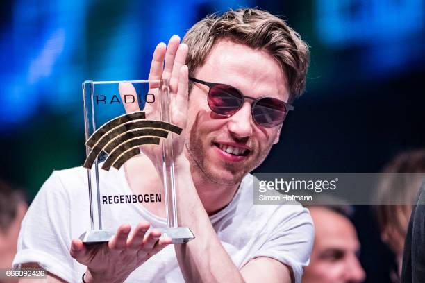 Clueso poses with his award during the Radio Regenbogen Award 2017 at Europapark on April 7 2017 in Rust Germany