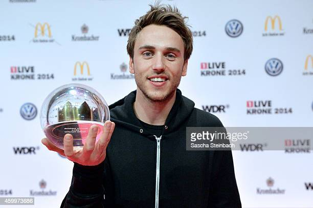 Clueso poses with the award during the 1Live Krone 2014 at Jahrhunderthalle on December 4 2014 in Bochum Germany