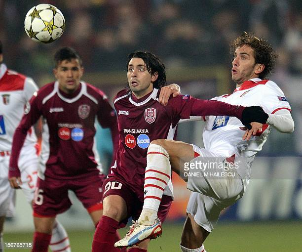 Cluj's Portuguese midfielder Rui Pedro and Braga's defender Nuno Coelho vie for the ball during the UEFA Champions League Group H match CFR 1907 Cluj...