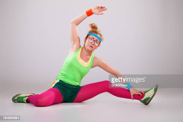 Clumsy fitness girl doing exercises
