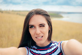 Funny girl taking too close bad angle self portraits