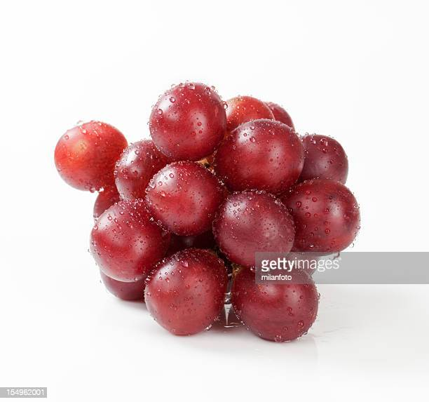 Cluster of red grapes on a white background